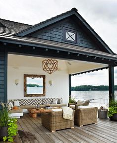 Have the roof of the boat house extend over the dock for a covered seating area.
