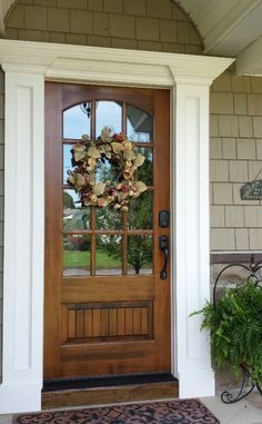 Dark walnut stain on front door. I like the idea of the reflective mirror so tha… Dark walnut stain on front door. Wood Doors, House Front, Entry Doors, Entrance Decor, Exterior Doors, Farmhouse Front, Doors, Front Door Decor, Door Color