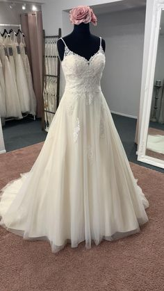 A beautiful a line style, with a v neckline, delicate shoulder straps, a lace bodice, scattered lace motifs and finished with spaghetti strap detail on the back Discount Designer Wedding Dresses, Lace Bodice, Dream Wedding Dresses, Bridal Boutique, Shoulder Straps, Townhouse, Spaghetti, Delicate, Neckline