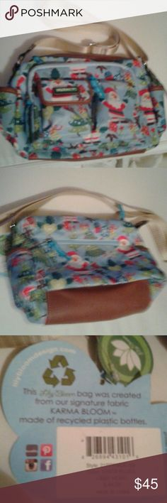 Lily Bloom X-mas purse nwt Beautifully designed with Santa, trees, gingerbread and x-mas deco with background baby blue. Has 3 pockets in front, one in back and inside. Had surgery and was housebound and never got to use it. Cost was over $50 dollars. Has adjustable strap. Lily Bloom  Bags Crossbody Bags