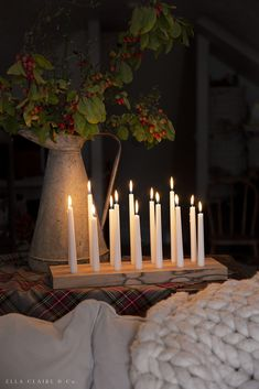 Make these easy DIY wooden candle holders with inexpensive wood and my favorite taper candles! This candlestick holder makes a perfect Christmas or hostess gift, can be used for holiday entertaining and tablescapes, and even birthday parties! Customize to fit your decor style!