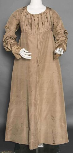 SILK TAFFETA DAY DRESS, c. 1800 Light olive green, long sleeves, high empire bodice w/ 2 seams, CB knife pleats, narrow bodice, string tie neckline, homespun linen bodice lining, L 48.5""