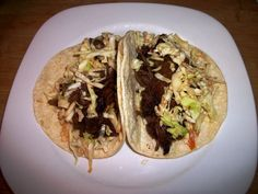 Korean Shredded Beef Tacos -- Being Korean and eating my fair share of Korean BBQ in my life, I knew I had to give this recipe a try when I came across it. While it is not authentic Korean BBQ, its very good. The best part is that it cooks all day in the crockpot and hardly any prep work!