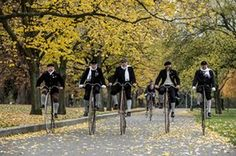 Enthusiasts in historical dress ride high-wheel bicycles during the traditional Prague Mile race
