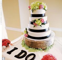 "Cake Table decor - black words ""I DO"" against white table cloth"