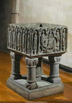 Baptismal font in Skjeberg church, Norway, 1125-1150. Soapstone, English style, showing Christ, Saint Mary and the apostles. The font is large enough to immerse the entire body of the chid, as was the medieval custom.