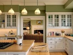 kitchen ... white cabinets, green walls, wood countertops, add red