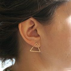 Simple and Modern enough to be worn on a daily basis. These tiny 6mm Vs are soldered with solid 10mm sterling silver posts and have a 19mm open triangle that hangs on the back of the ear post. Earring backs and ear nuts are also solid sterling silver. They fit my ears perfectly. They