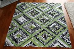 a black, white and green baby string quilt