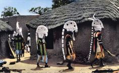 Africa | Senufo dancers during a ritual ceremony. Ouagadougou, Burkina Faso. Post stamped 1957. || Scanned postcard; publisher Hoa Qui