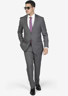 Suit includes jacket & trousers 2-button single breast jacket Notch lapels Flap pockets Side vents Suit includes jacket & trousers Fit: Slim Fit Comfort: Stretch Armhole for comfort Material: 98% Wool 2% Spandex Color: Charcoal Grey Windowpane