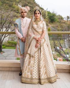 Loving the pop of gold and green jewelry with her ivory lehenga! You're missing out on a lot of you still haven't checked out… designer bridal lehenga Bridal Hairstyle Indian Wedding, Sikh Wedding, Ivory Wedding, Indian Bridal, Reception Suits, Designer Bridal Lehenga, Indian Wedding Planning, Red Suit, Groom Outfit