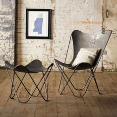 Iron Sling Chair in Raw Metal The Iron Sling Chair brings modern design to an ancient material. Inspired by the graceful, curving form of a paperclip, the chair provides a poised presence in any space.
