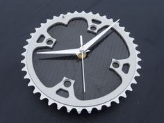 Unique carbon fiber cycling wall clock made from a MTB bicycle gear. $54.00, via Etsy.