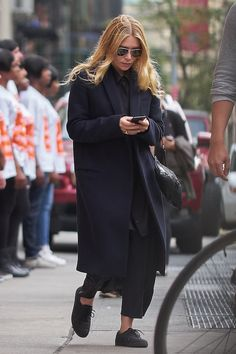 How Ashley Olsen Wore Black Sneakers At NYFW