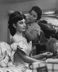 Audrey Hepburn getting flowers pinned in her hair for her role as Marie Vetsera in Mayerling in NYC January 1957.