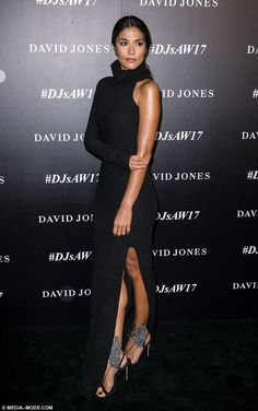 Dazzling: The model wore a turtle neck-style gown, that featured one long sleeve and a thigh-high slit