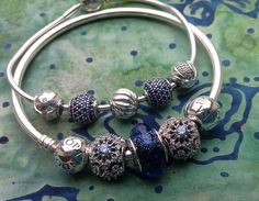 Pandora favourites, Disney Cinderella , Iridescent Blue Murano, and Peace Essence charms. Beautiful blues!