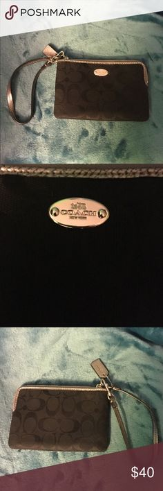 Authentic Coach wristlet I got this as a gift for Christmas last year. I never used it. Coach Bags Clutches & Wristlets