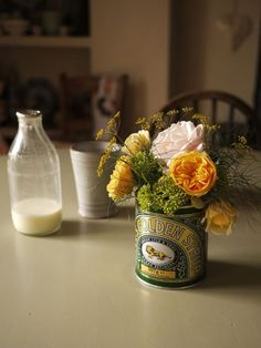 Tabletop flowers in a Lyles golden syrup tin - great for al fresco dining