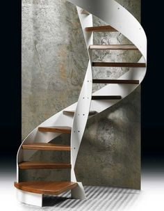 Gorgeous spiral steel staircases by Rizzi in Vicenza. They also do concrete and wood that are equally beautiful. I saw these in person at MADE expo last year... really nicely crafted.
