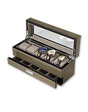 """With its glass top, this handsome five-watch storage box neatly displays his collection. Crafted of lacquered silver walnut with chrome accents and lined in soft velour, the top features five removable cushioned inserts that accommodate watches up to 50mm. The lower drawer is divided into five compartments to organize his tie clips, cufflinks, and other accessories. In gray. 12""""L x 4¼""""W x 5""""H. Wipe clean with soft cotton cloth. Imported."""