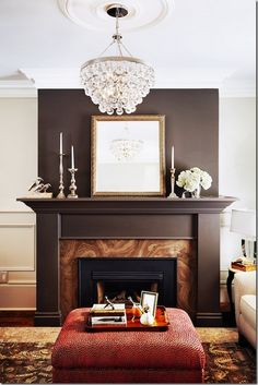 Bling lighting among chocolate contrast of fireplace<3: Chandelier, Design Fireplaces, Livingroom