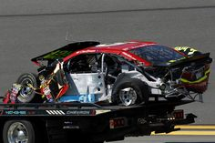 The #15 5-hour ENERGY Toyota, driven by Clint Bowyer, is towed off the track during qualifying for the 57th Annual Daytona 500 at Daytona International Speedway on February 15, 2015 in Daytona Beach, Florida