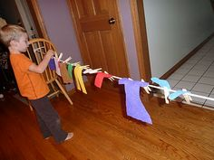 Clothesline with felt clothing- good for fine motor skills.  You could also use a collapsible clothes rack & infant/toddler clothes! Easy storage!