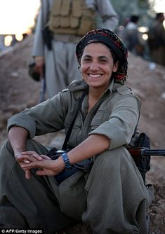 A female member of the Kurdistan Workers' Party (PKK) poses as she takes position on the front line in Makhmur some 50 km south of Arbil, the capital of the autonomous Kurdish region of northern Iraq where clashes with Islamic State (IS) militants are ongoing.