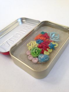 Miniature Clay Coral Reef Tin with Starfish by TinyTropicals  #polymerclay #altoidstin #altoidspond #miniature #coral  #diorama #aquarium #ocean #anemone #fish  This miniature pond can be found on www.etsy.com/shop/tinytropicals