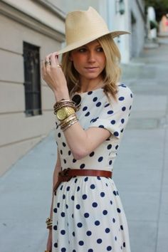 Chic polka dots with belt, nude hat,and layered gold jewels.