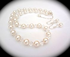 Bridal jewelry. Swarovski pearl earrings and necklace set with backdrop. Classic and super sparkly pearl and crystal set.....perfect for the