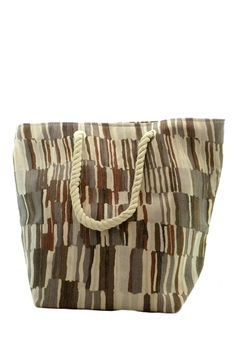 """Abstract strokes of assorted earth tones adorn this generously sized tote as taupe russet coffee slate and beige come together in soft even artistic stripes and a silver thread is woven throughout giving it a cool shimmer.  The bag has double 20""""handles making a 9"""" shoulder drop.  The thick cotton rope straps are extremely sturdy.  Bottom width is 10"""" and depth is 7"""".  Top width is 16"""" when flat and fastened with a sturdy magnetic closure.  The height of the bag is 13 1/2"""" tall.  The tote is…"""