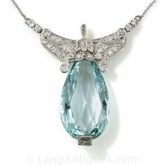 Art Deco Aquamarine and Diamond Necklace. Ravishing is the word. A cool, crystalline, pastel blue aquamarine, weighing about 30 carats and fashioned into an enchanting briolette cut, is regally crowned in platinum and diamonds in this rare original Art Deco necklace - circa 1925. If you look closely, the central loop section is composed of double-bullet shaped diamonds flanked by trapezoid-cuts and topped with a slender pear shape