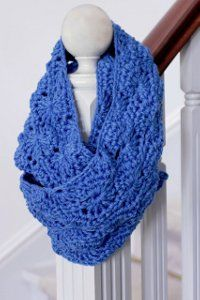 Two strands of yarn are worked together to create this Periwinkle Infinity Scarf. The double crochet stitch is worked in rows with the finished product measuring 65 inches around and 8 inches wide, depending on how tight or loose you crochet.