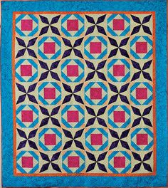 Batiks shine and pop in this quilt. Easy to make with machine applique' blocks. Pieced Brain