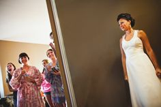 Bridesmaids react to bride in her dress, by The Rasers.  Wedding in Wildwood, MO.