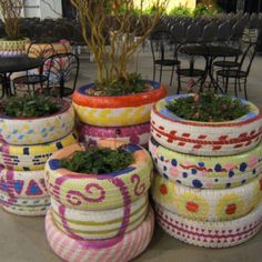 bygardendawn in recycling in the garden : Chic tire planters at Chicago Flower Garden show image by Dawn Sherwood Garden Crafts, Garden Projects, Diy Projects, Garden Ideas, Garden Art, Tire Planters, Garden Planters, Painted Tires, Reuse Old Tires