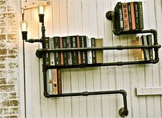 Pipe shelves. I love that they're light fixtures as well. And, it would be super easy to add a plank of wood, maybe raw-edged, to give more surface area to the shelf...
