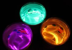 Make glowing drinking cups by taking two plastic cups, one clear and one opaque, and put a glow stick bracelet in the bottom of the opaque cup and then take the clear cup and stack it on top. Just add ice and sprite or some clear drink and you have a cool, glowing drink in your hand!