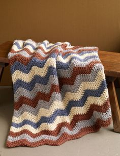 Clockhouse Ripple Afghan, pattern free at lionbrand.com... reminds me of taking naps at my grandma's :)