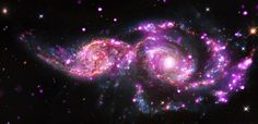 'Tis the season for holiday light shows, and two galaxies about 130 million light years from Earth got together to put on a display of their own. NGC 220