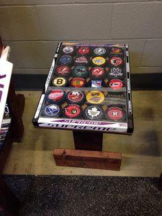 table made from hockey sticks and decorated with pucks Boys Hockey Room, Hockey Man Cave, Hockey Bedroom, Hockey Puck, Hockey Mom, Hockey Sticks, Hockey Stuff, Hockey Stick Crafts, Hockey Decor