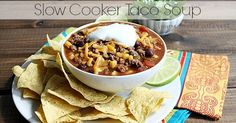 Beef, black, beans, corn, and a spicy broth make this slow cooker taco soup perfect for simple summer dinners, or a game day meal.