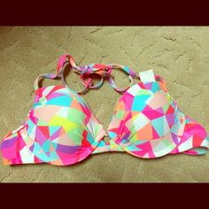NWT Xhilaration Neon Geometric Bikini Swim Top Size Large. From summer 2015. New with tags, never worn! I purchased it in 2 sizes and kept the other. Xhilaration Swim Bikinis