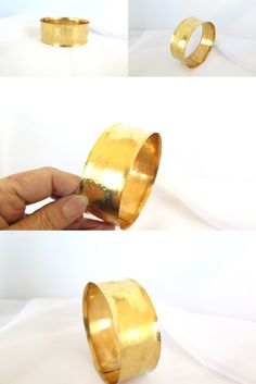 This is a beautiful way to cover up a tattoo.This wide cuff is large enough to go around your upper arm. It is all hand forged from nu gold brass, and hand fin