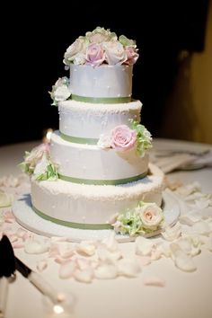 white cake with pastel pink and green flowers - Check out navarragardens.com for info on a beautiful Oregon wedding destination!