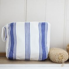 We love this simple linen washbag. Perfect for storing make up and toiletries