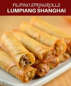 Lumpiang Shanghai filled with ground chicken, water chestnuts, and green onions. Golden, crisp and in fun bite-size, these Filipino meat spring rolls are absolutely addicting! Filipino Dishes, Filipino Recipes, Asian Recipes, Ethnic Recipes, Filipino Food Party, Lumpia Recipe Filipino, I Love Food, Good Food, Yummy Food